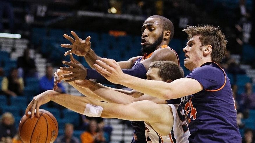 Auburn's Jack Purchase, right, and teammate KT Harrell battle for the ball with Oregon State's Matt Dahlen during the first half of an NCAA college basketball game Wednesday, Nov. 26, 2014, in Las Vegas. (AP Photo/John Locher)