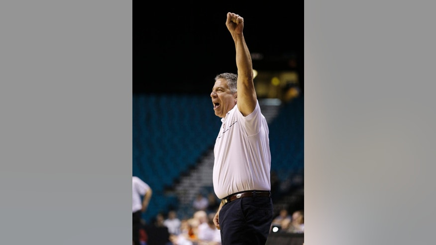Auburn head coach Bruce Pearl celebrates after a play against Oregon State during the second half of an NCAA college basketball game Wednesday, Nov. 26, 2014, in Las Vegas. Auburn won 71-69. (AP Photo/John Locher)