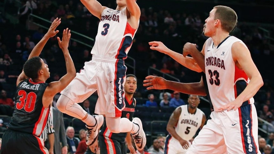 Gonzaga guard Kyle Dranginis (3) goes up for a layup with Georgia guard J.J. Frazier  (30) defending and Gonzaga forward Kyle Wiltjer (33) looking on in the first half of an NCAA college basketball game at Madison Square Garden in New York, Wednesday, Nov. 26, 2014. (AP Photo/Kathy Willens)