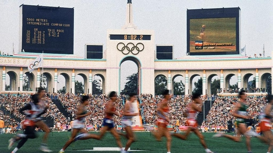 FILE - This Aug. 11, 1984, file photo shows a field of entrants during the Men's 5,000 meter event at the Summer Olympic Games in Los Angeles. Glamour, celebrities, perfect weather. A revitalized and growing downtown. Iconic venues and political support. With these virtues, Los Angeles looks like an ideal fit to host the 2024 Olympics.  (AP Photo, File)