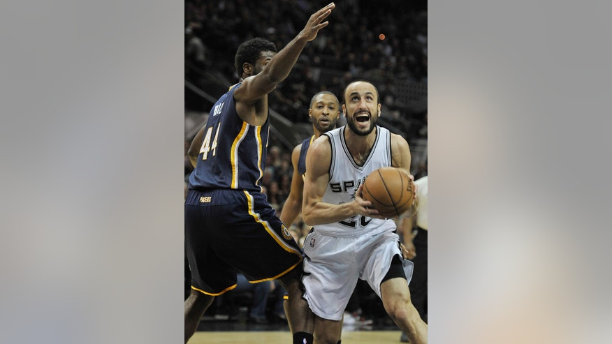 San Antonio Spurs guard Manu Ginobili, right, of Argentina, drives around Indiana Pacers forward Solomon Hill during the first half of an NBA basketball game, Wednesday, Nov. 26, 2014, in San Antonio. (AP Photo/Darren Abate)