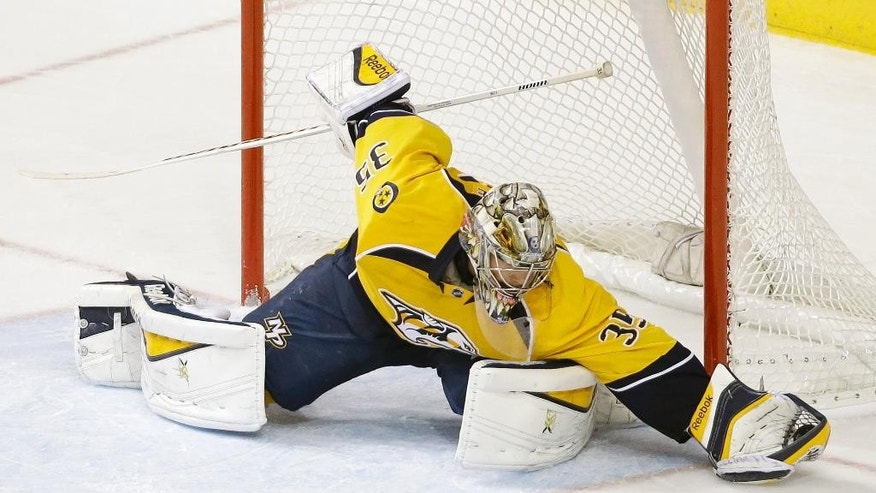 Nashville Predators goalie Pekka Rinne, of Finland, makes a stop against the Los Angeles Kings in overtime at an NHL hockey game Tuesday, Nov. 25, 2014, in Nashville, Tenn. The Predators won 4-3 in a shootout. (AP Photo/Mark Humphrey)