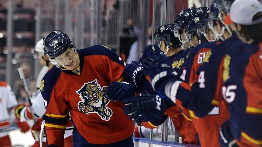 Florida Panthers center Nick Bjugstad, left, is congratulated by teammates after scoring a goal in the first period of an NHL hockey game against the Carolina Hurricanes, Wednesday, Nov. 26, 2014, in Sunrise, Fla. (AP Photo/Lynne Sladky)