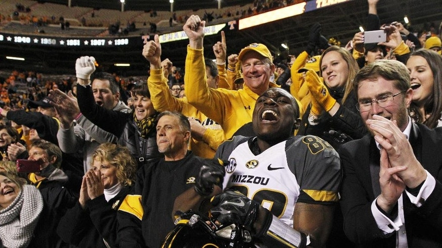 Missouri wide receiver Jimmie Hunt (88) celebrates with fans after an NCAA college football game against Tennessee on Saturday, Nov. 22, 2014, in Knoxville, Tenn. Missouri won 29-21. (AP Photo/Wade Payne)