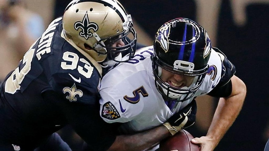 Baltimore Ravens quarterback Joe Flacco (5) is sacked by New Orleans Saints outside linebacker Junior Galette (93) in the first half of an NFL football game in New Orleans, Monday, Nov. 24, 2014. (AP Photo/Jonathan Bachman)