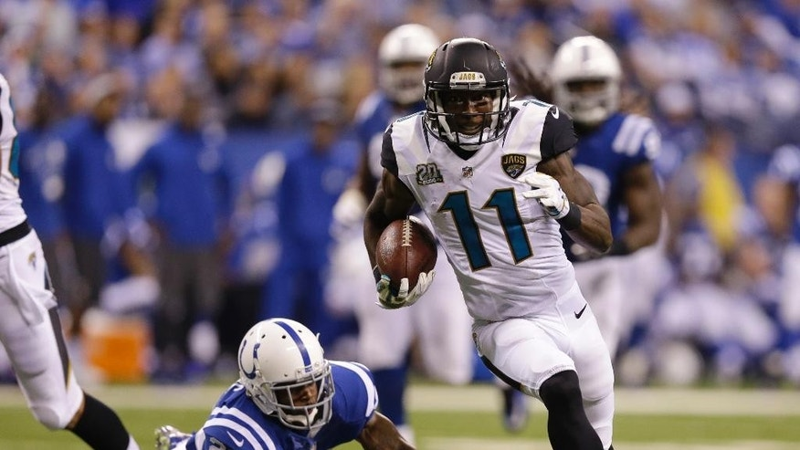 Jacksonville Jaguars wide receiver Marqise Lee (11) runs past Indianapolis Colts strong safety Mike Adams (29) during the second half of an NFL football game Sunday, Nov. 23, 2014 in Indianapolis. (AP Photo/Michael Conroy)