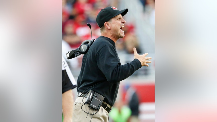 San Francisco 49ers head coach Jim Harbaugh yells during the third quarter of an NFL football game against the Washington Redskins in Santa Clara, Calif., Sunday, Nov. 23, 2014. (AP Photo/Tony Avelar)