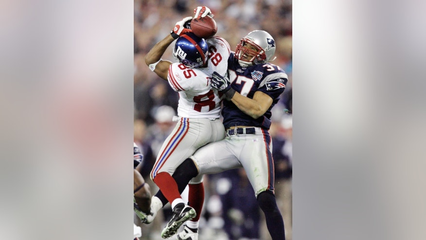 FILE - In this Feb. 3, 2008, file photo, New York Giants receiver David Tyree (85) catches a 32-yard pass in the clutches of New England Patriots safety Rodney Harrison (37) during the fourth quarter of the Super Bowl XLII football game in Glendale, Ariz. The one-handed catch by New York Giants' Odell Beckham Jr. that became the most talked-about play from Sunday, Nov. 23, 2014,  did more than just boost his standing with the New York Giants, it paid off a routine growing popular among many skill players of practicing the impractical, one-handed circus grab. (AP Photo/Gene J. Puskar, File)