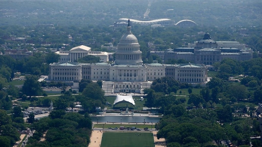 FILE - In this May, 2014 file photo, RFK Memorial Stadium is visible behind the U.S. Capitol from the 500-foot level of the Washington Monument in Washington. Local organizers believe a major project such as the Olympics would be able to bring groups in the city together, even Republicans and Democrats.  (AP Photo/File)