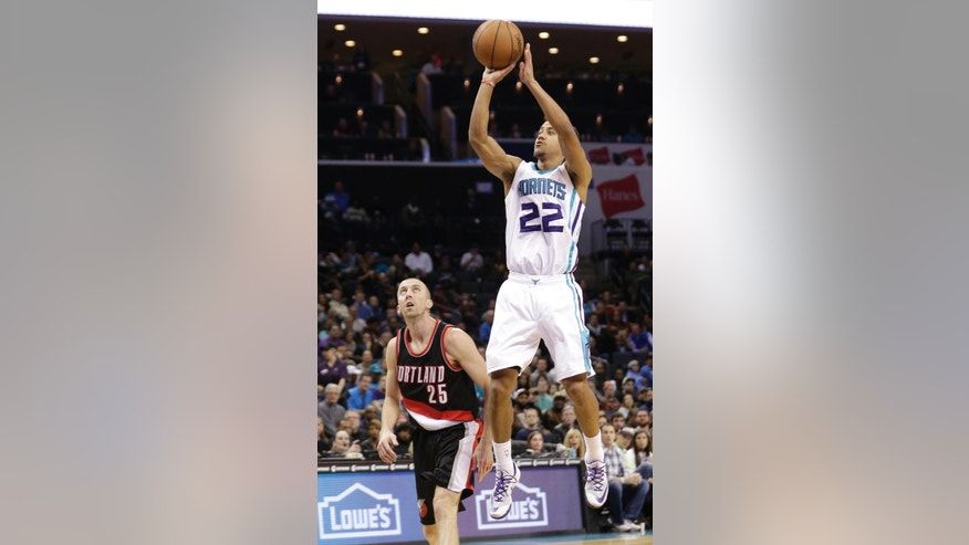 Charlotte Hornets' Brian Roberts (22) shoots over Portland Trail Blazers' Steve Blake (25) during the first half of an NBA basketball game in Charlotte, N.C., Wednesday, Nov. 26, 2014. (AP Photo/Chuck Burton)