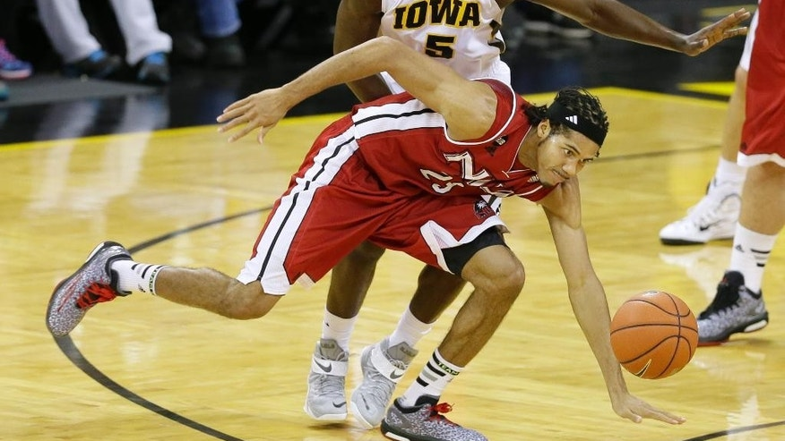 Northern Illinois guard Aaric Armstead loses the ball in front of Iowa guard Anthony Clemmons, rear, during the second half of an NCAA college basketball game, Wednesday, Nov. 26, 2014, in Iowa City, Iowa. (AP Photo/Charlie Neibergall)