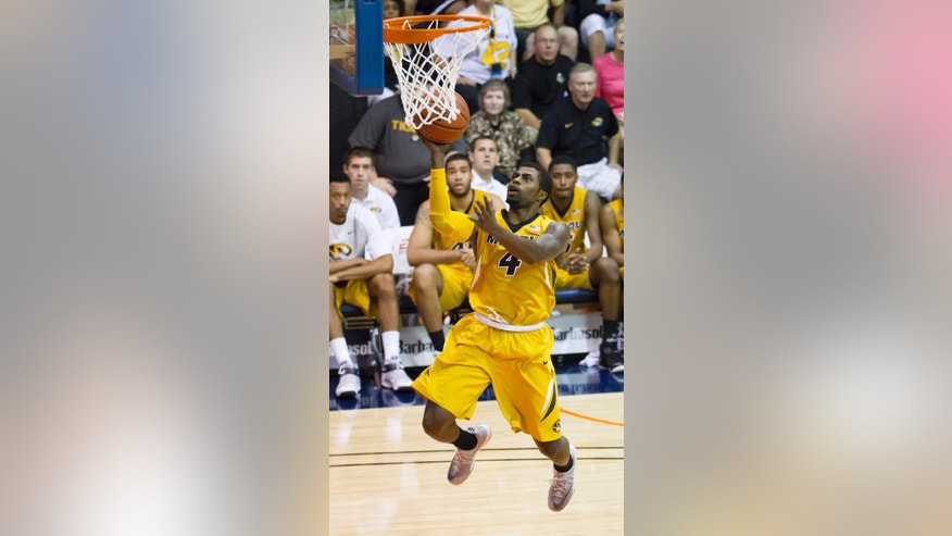 Missouri guard Tramaine Isabell (4) shoots on a fast break while playing against Chaminade in the second half of an NCAA college basketball game at the Maui Invitational on Wednesday, Nov. 26, 2014, in Lahaina, Hawaii. Missouri won 74-60. (AP Photo/Eugene Tanner)