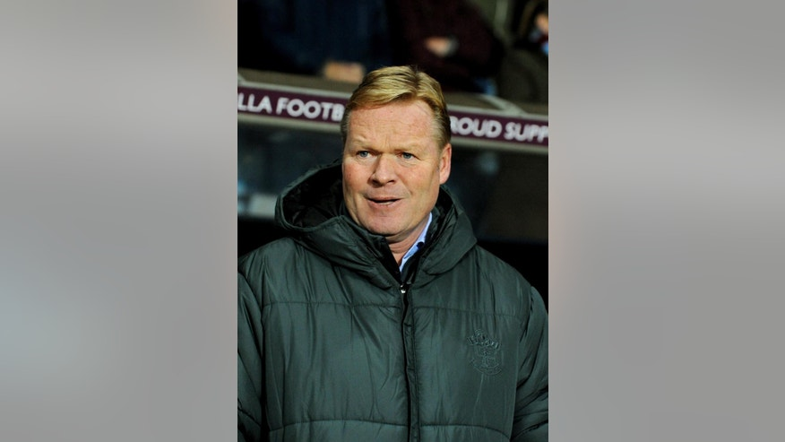 Southampton manager Ronald Koeman looks on during the English Premier League soccer match between Aston Villa and Southampton at Villa Park, Birmingham, England, Monday, Nov. 24, 2014. (AP Photo/Rui Vieira)