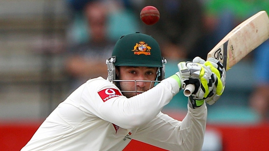 Dec. 14, 2014: Australia's Phil Hughes ducks under a bouncer from Sri Lanka's Shaminda Eranga on the first day of their cricket test match at Bellerive Oval in Hobart