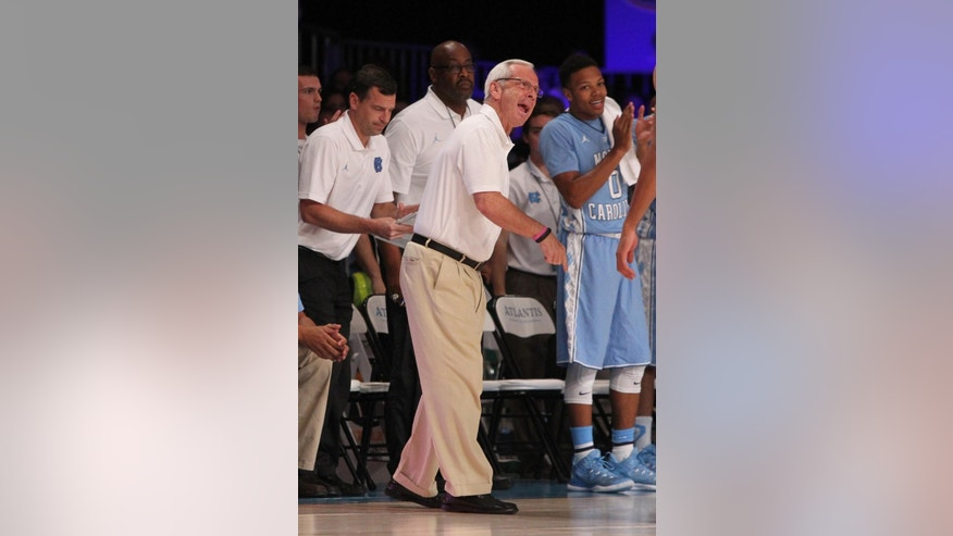 UNC's head coach Roy Williams directs his players during their game against UCLA in the Battle 4 Atlantis basketball tournament in Paradise Island, Bahamas, Thursday Nov. 27, 2014. (AP Photo/Tim Aylen)