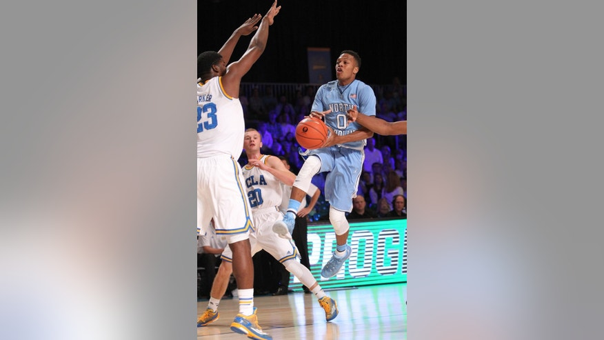 UNC's Nate Britt (0) goes for a jump shot against UCLA's Tony Parker (23) during their game in the Battle 4 Atlantis basketball tournament in Paradise Island, Bahamas, Thursday Nov. 27, 2014. (AP Photo/Tim Aylen)