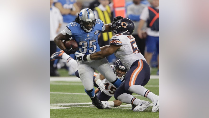 Detroit Lions running back Joique Bell (35) stiff arms Chicago Bears inside linebacker Jon Bostic (57) during the second half of an NFL football game in Detroit, Thursday, Nov. 27, 2014. (AP Photo/Duane Burleson)