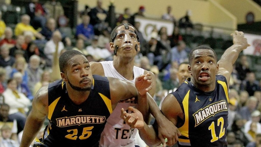 Georgia Tech forward Quinton Stephens fights for a rebound with Marquette guard Derrick Wilson (12) and forward Steve Taylor Jr. (25) during the first half of an NCAA college basketball game in Lake Buena Vista, Fla., Thursday, Nov. 27, 2014. (AP Photo/Reinhold Matay)