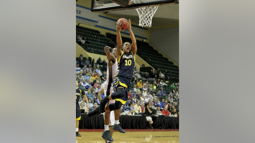 Georgia Tech forward Robert Sampson, behind, cannot stop Marquette forward Juan Anderson (10) during the first half of an NCAA college basketball game in Lake Buena Vista, Fla., Thursday, Nov. 27, 2014. (AP Photo/Reinhold Matay)