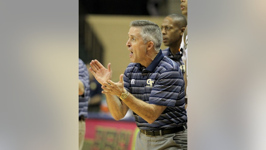 Georgia Tech head coach Brian Gregory reacts during the first half of an NCAA college basketball game against the Marquette in Lake Buena Vista, Fla., Thursday, Nov. 27, 2014. (AP Photo/Reinhold Matay)