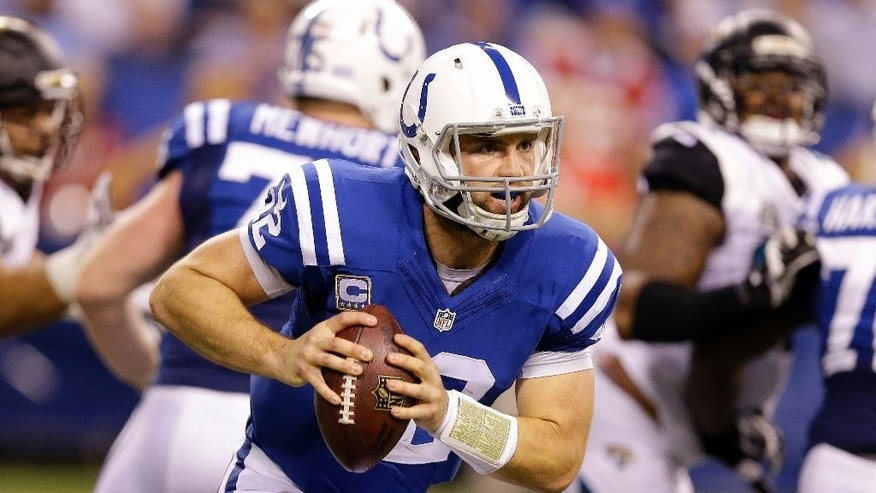 Indianapolis Colts quarterback Andrew Luck (12) runs during the first half of an NFL football game against the Jacksonville Jaguars, Sunday, Nov. 23, 2014, in Indianapolis. (AP Photo/Michael Conroy)