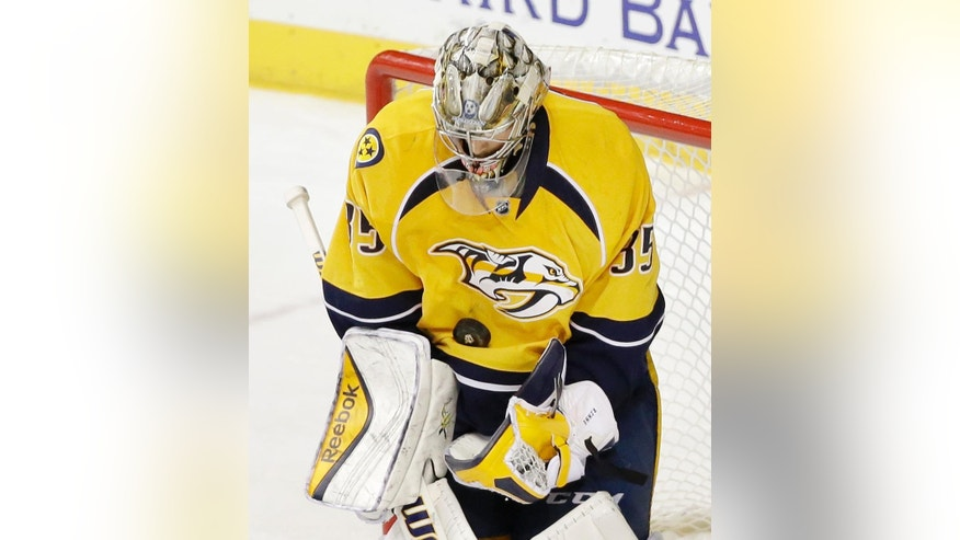 Nashville Predators goalie Pekka Rinne, of Finland, blocks a shot against the Edmonton Oilers in the second period of an NHL hockey game Thursday, Nov. 27, 2014, in Nashville, Tenn. (AP Photo/Mark Humphrey)