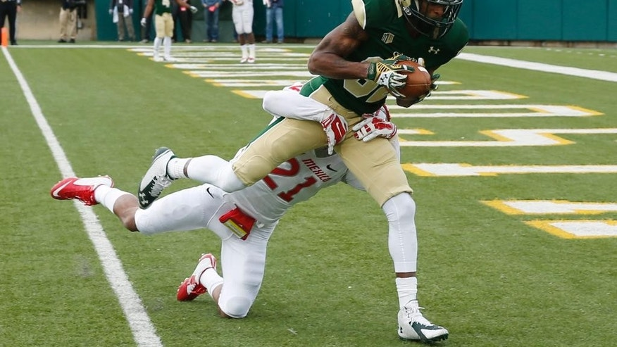 Colorado State wide receiver Rashard Higgins, front, drags New Mexico defensive back Donnie Duncan into the end zone for a touchdown after catching a pass in the third quarter of Colorado State's 58-20 victory in an NCAA college football game in Fort Collins, Colo., on Saturday, Nov. 22, 2014. (AP Photo/David Zalubowski)