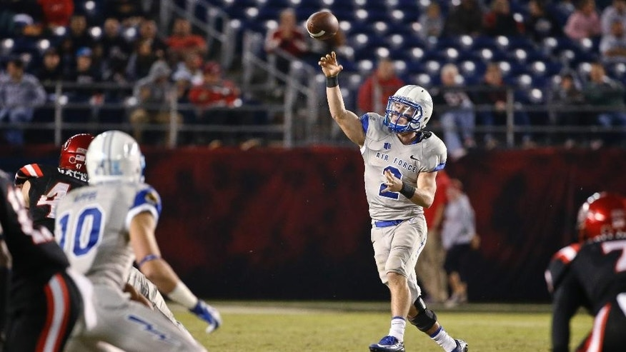 Air Force quarterback Kale Pearson throws on the run against San Diego State during the second half of an NCAA college football game Friday, Nov. 21, 2014, in San Diego. San Diego State won 30-14. (AP Photo/Lenny Ignelzi)