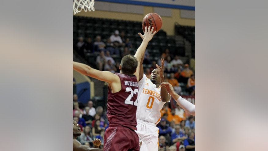 Tennessee guard Kevin Punter (0) shoots over Santa Clara forward Matt Hubbard (22) during the first half of an NCAA college basketball game in Lake Buena Vista, Fla., Thursday, Nov. 27, 2014. (AP Photo/Reinhold Matay)