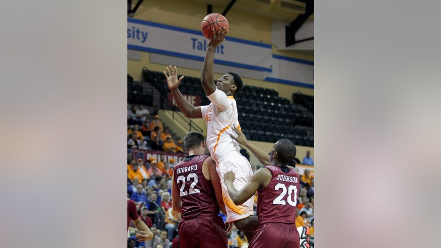 Santa Clara forward Matt Hubbard (22) and guard Denzel Johnson (20) try to stop Tennessee forward Armani Moore (4) during the first half of an NCAA college basketball game in Lake Buena Vista, Fla., Thursday, Nov. 27, 2014. (AP Photo/Reinhold Matay)
