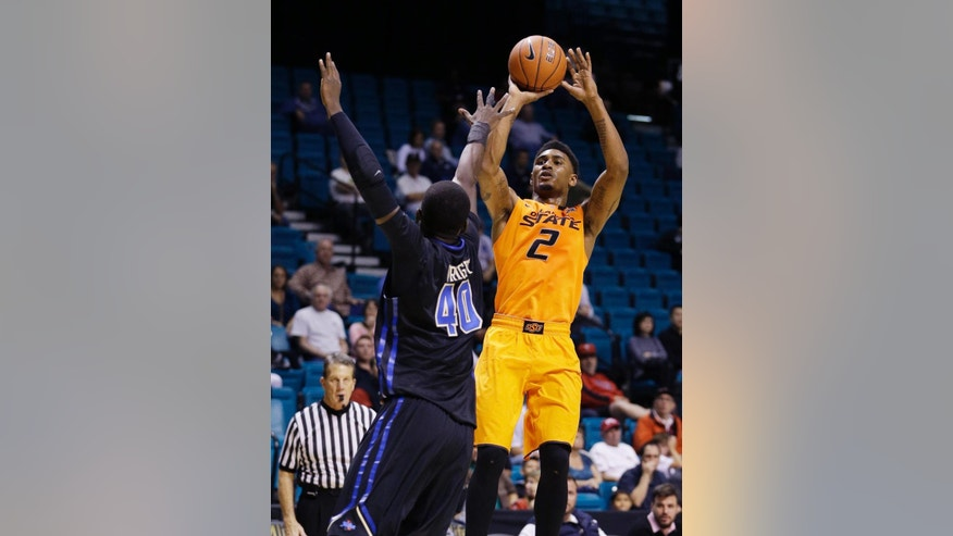 Oklahoma State's Le'Bryan Nash (2) goes up for a shot against Tulsa forward D'Andre Wright (40) during the first half of an NCAA college basketball game Wednesday, Nov. 26, 2014, in Las Vegas. (AP Photo/John Locher)
