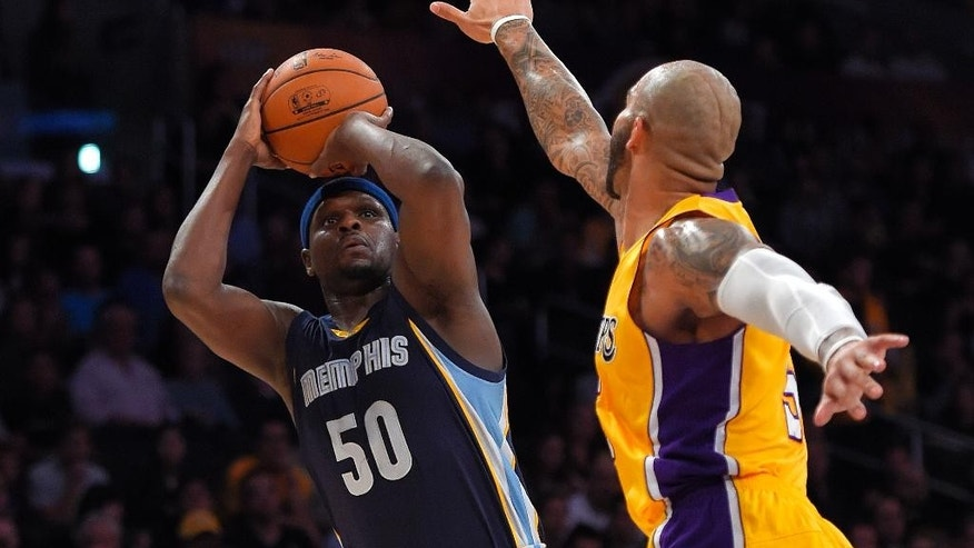Memphis Grizzlies forward Zach Randolph, left, puts up a shot Los Angeles Lakers center Robert Sacre defends during the first half of an NBA basketball game, Wednesday, Nov. 26, 2014, in Los Angeles. (AP Photo/Mark J. Terrill)