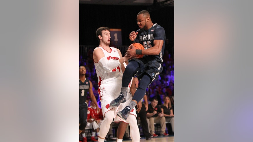 Georgetown's Jabril Trawick (55) and Wisconsin's Frank Kaminsky (44) fight for the ball during their game in the Battle 4 Atlantis basketball tournament in Paradise Island, Bahamas, Thursday Nov. 27, 2014. (AP Photo/Tim Aylen)