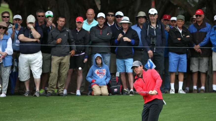 Northern Ireland's Rory McIlroy watches his chip shot during the first round of the Australian Open golf championship in Sydney, Australia Thursday, Nov. 27, 2014. McIlroy shot a 2-under 69. (AP Photo/Rick Rycroft)
