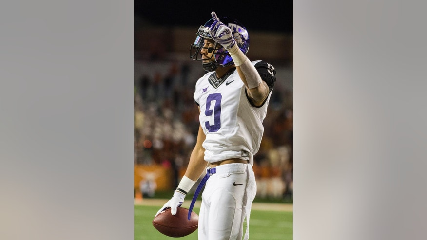 TCU's Josh Doctson (9) celebrates a catch during the first half of an NCAA college football game against Texas, Thursday, Nov. 27, 2014, in Austin, Texas. (AP Photo/Ashley Landis)