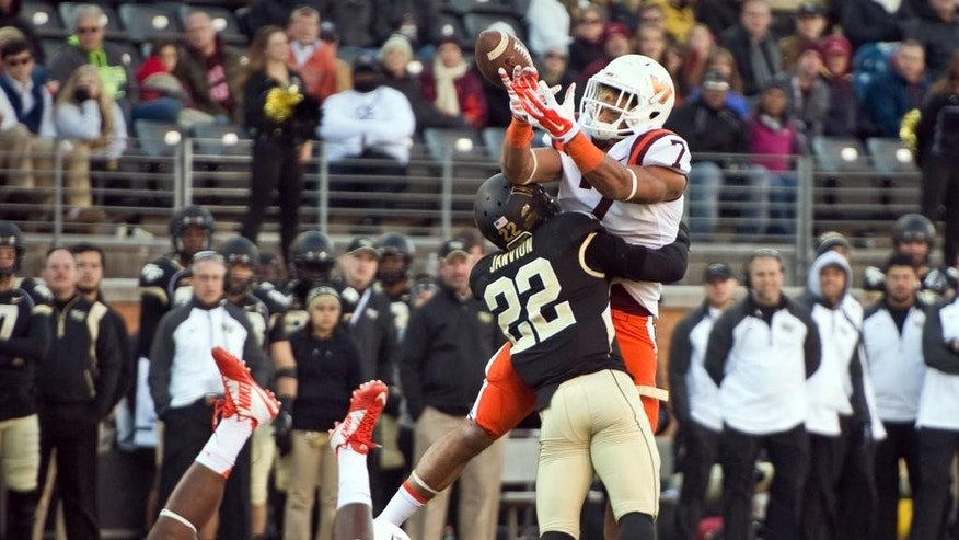 Wake Forest safety Ryan Janvion (22) forces a fumble from Virginia Tech tight end Bucky Hodges (7) as Hodges receives a lateral during an NCAA college football game, Saturday, Nov. 22, 2014 at BB&T Field in Winston-Salem, N.C. Wake Forest recovered the fumble for a first down. (AP Photo/Winston-Salem Journal, Andrew Dye)