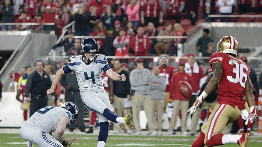 Seattle Seahawks kicker Steven Hauschka (4) kicks a 36-yard field goal from the hold of Jon Ryan against the San Francisco 49ers during the second quarter of an NFL football game in Santa Clara, Calif., Thursday, Nov. 27, 2014. The Seahawks won 19-3. (AP Photo/Marcio Jose Sanchez)