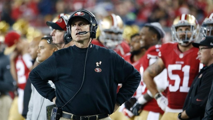 San Francisco 49ers head coach Jim Harbaugh stands on the sideline during the fourth quarter of an NFL football game against the Seattle Seahawks in Santa Clara, Calif., Thursday, Nov. 27, 2014. The Seahawks won 19-3. (AP Photo/Tony Avelar)