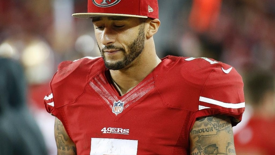 San Francisco 49ers quarterback Colin Kaepernick (7) stands on the sideline during the fourth quarter of an NFL football game against the Seattle Seahawks in Santa Clara, Calif., Thursday, Nov. 27, 2014. The Seahawks 19-3. (AP Photo/Tony Avelar)