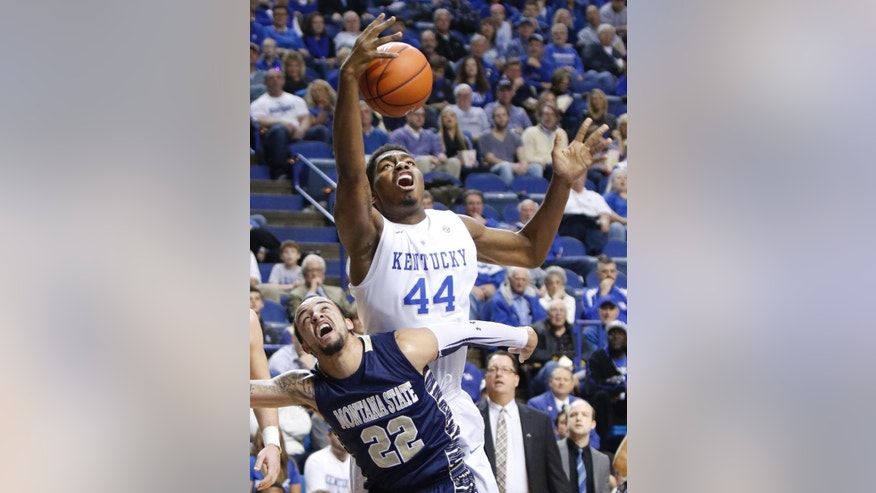 Kentucky's Dakari Johnson (44) and Montana State's Marcus Colbert (2) battle for a rebound during the first half of an NCAA college basketball game, Sunday, Nov. 23, 2014, in Lexington, Ky. (AP Photo/James Crisp)