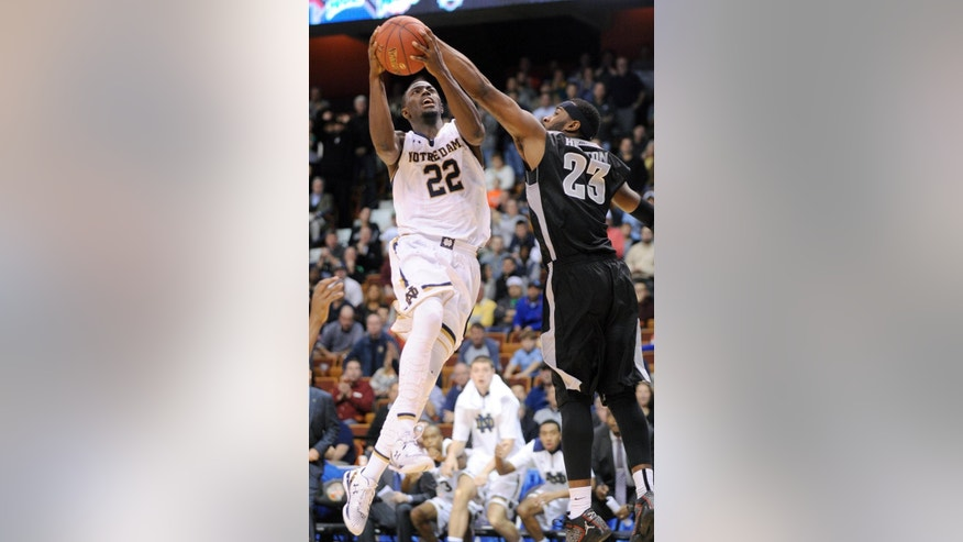 Notre Dame's Jerian Grant (22) drives past Providence's LaDontae Henton during the second half of Providence's 75-74 victory in an NCAA college basketball game in Uncasville, Conn., on Sunday, Nov. 23, 2014. Grant scored a team-high 20 points in the loss. (AP Photo/Fred Beckham)
