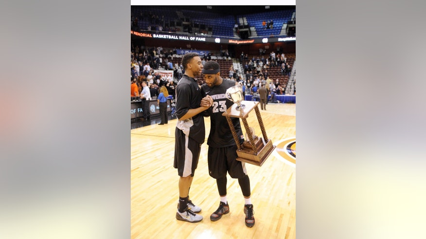 Providence's LaDontae Henton, right, and Jalen Lindsey celebrate after their 75-74 victory over Notre Dame in an NCAA college basketball game in Uncasville, Conn., Sunday, Nov. 23, 2014. Henton scored a career-high 38 points in the victory. (AP Photo/Fred Beckham)