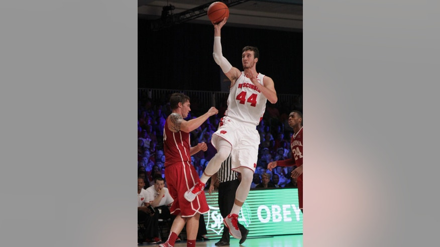 Wisconsin's Frank Kaminsky sets up the shot during their championship game against Oklahoma in the Battle 4 Atlantis basketball tournament in Paradise Island, Bahamas, Friday, Nov. 28, 2014. (AP Photo/Tim Aylen)