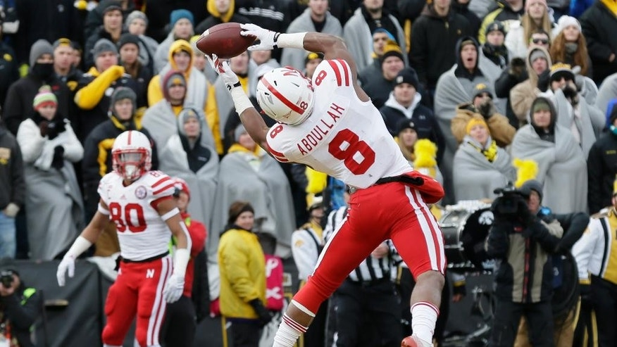 Nebraska running back Ameer Abdullah (8) catches a 5-yard touchdown pass for a touchdown during the first half of an NCAA college football game against Iowa, Friday, Nov. 28, 2014, in Iowa City, Iowa. (AP Photo/Charlie Neibergall)