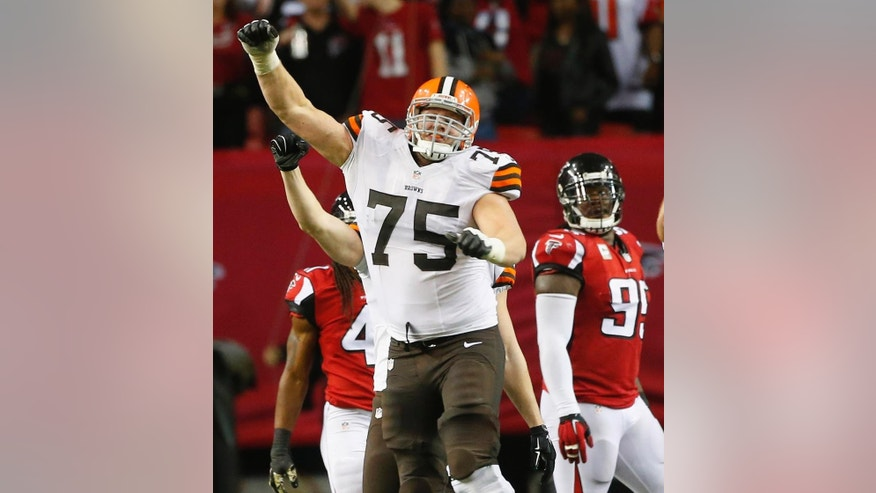 Cleveland Browns guard Joel Bitonio (75) celebrates Cleveland Browns kicker Billy Cundiff's game-winning field goal against the Atlanta Falcons after the second half of an NFL football game, Sunday, Nov. 23, 2014, in Atlanta. The Cleveland Browns won 26-24. (AP Photo/John Bazemore)