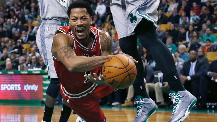 Chicago Bulls guard Derrick Rose falls after being tripped while driving against the Boston Celtics in the first half of an NBA basketball game in Boston, Friday, Nov. 28, 2014. (AP Photo/Elise Amendola)