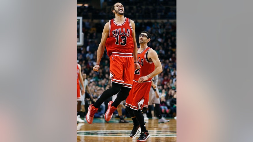 Chicago Bulls center Joakim Noah (13) celebrates with guard Kirk Hinrich, right, after making a crucial basket in the last minute of an NBA basketball game against the Boston Celtics in Boston, Friday, Nov. 28, 2014. The Bulls won 109-102. (AP Photo/Elise Amendola)