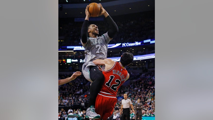 Boston Celtics forward Jared Sullinger (7) drives against Chicago Bulls guard Kirk Hinrich (12) in the second half of a basketball game in Boston, Friday, Nov. 28, 2014. The Bulls won 109-102. (AP Photo/Elise Amendola)