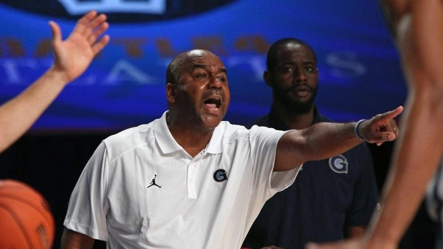 Georgetown head coach John Thompson III directs his players during their third place game against Butler in the Battle 4 Atlantis basketball tournament in Paradise Island, Bahamas, Friday Nov. 28, 2014. (AP Photo/Tim Aylen)