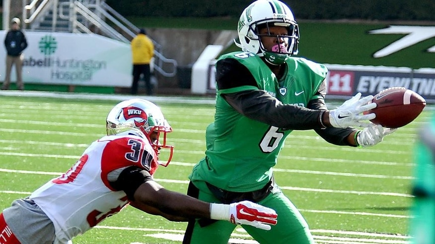Marshall's Davonte Allen tries to catch a pass in the end zone during an NCAA college football game against Western Kentucky in Huntington, W.Va., Friday, Nov. 28, 2014. (AP Photo/Chris Tilley)
